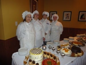 Triton College Culinary Students standing in front of their delicious desserts