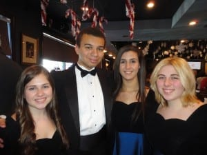 Four of the members from the Leyden High School Chamber Singers