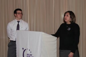 Carol Figarelli, Cancer Survivor and Team Captain of Figarelli Fighters, accompanied by her son, tells the audience of her journey through cancer.